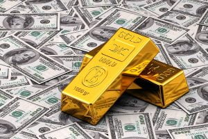 bigstock-gold-and-cash-36397461